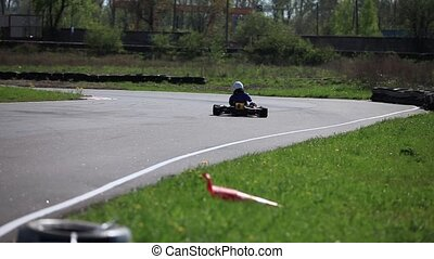 Race Go-kart in a curve rear view - racing track Go-kart in...