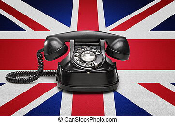 Old and vintage telephone on the union jack flag - Office:...