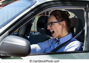 Woman stopping the car and screaming - Young elegant woman...