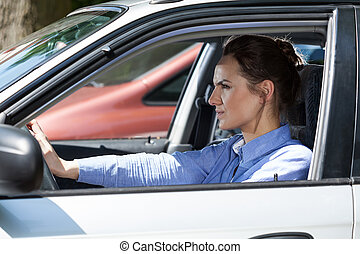 Angry woman in a traffic jam - Horizontal view of angry...