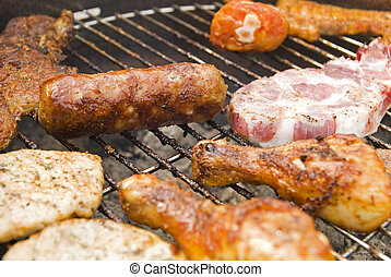 Sausages, beef and other meat on a barbecue