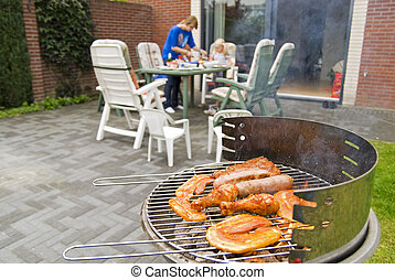 Meat and kebabs on barbecue.