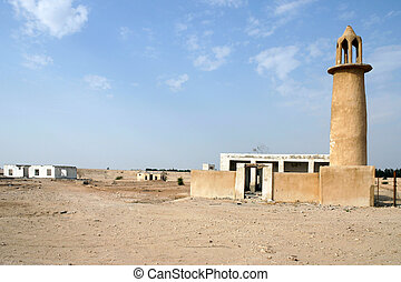 Abandoned mosque and houses - An abandoned mosque and...