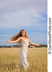 freedom in nature, young woman in summer