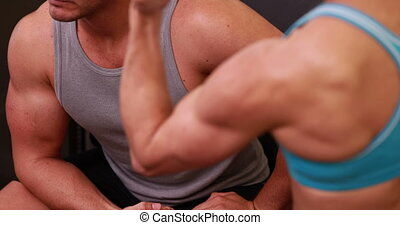 Fit people flexing their muscles at the gym