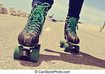 closeup of a young man roller skating, with a...