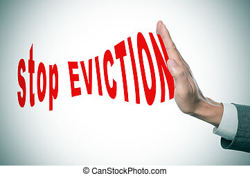 stop eviction - man hand stopping the text stop eviction