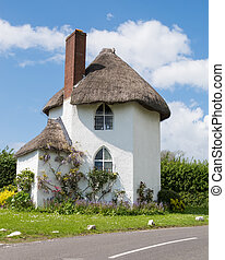White, Thatched Cottage - A picturesque white, thatched...