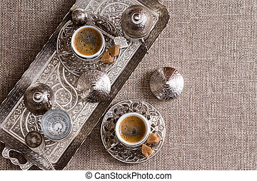 Traditional Turkish coffee for two served on an ornamental...