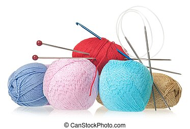 Colorful threads with knitting accessories isolated on white...