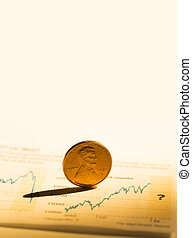 Penny on a growth chart - Photo of a penny on a growth...