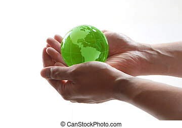 World in hands - Green glass globe in the palm of your...