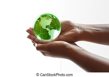 World in hands - Green glass globe in the palm of your hands...