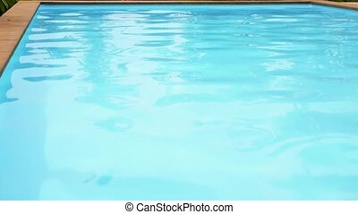 Unrippled Blue Water in Swimming Pool.