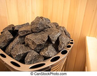 Mage of granite rock in sauna oven - Closeup image of...