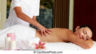 Beautiful brunette getting a massage in the health spa