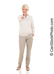 senior woman pointing - happy senior woman pointing isolated...