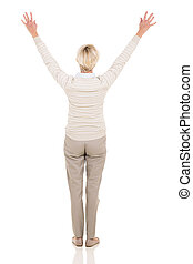 rear view of senior woman with arms up