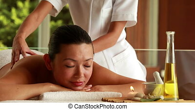 Gorgeous brunette getting a massage in the health spa