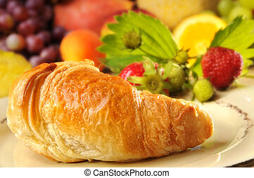 Croissant and fruits - croissant with fruits in the...