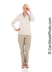 mature woman having headache standing isolated on white...