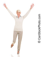 cheerful mid age woman arms up