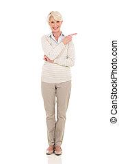 gorgeous senior woman pointing on white background