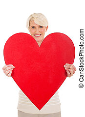 middle aged woman presenting heart shape - pretty middle...
