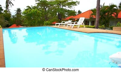 Private Swimming Pool Panorama in Tropical Thailand. Sunny...