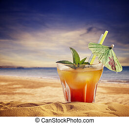 Cocktail and sandy beach summer concept