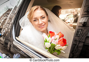 Bride with bouquet looking out of window - Closeup portrait...