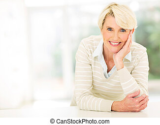 middle aged woman relaxing - smiling middle aged woman...