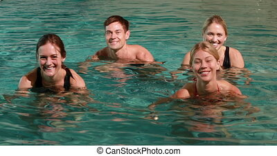 Four smiling people doing water aer