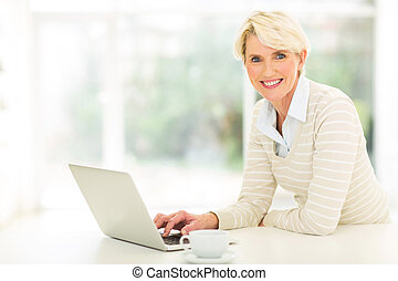 middle aged woman using computer - beautiful middle aged...