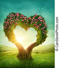 Heart shaped tree in the meadow