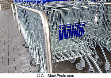 Empty Shopping Cart - Empty shopping cart in rank and file...