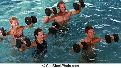 Fit people doing an aqua aerobics c