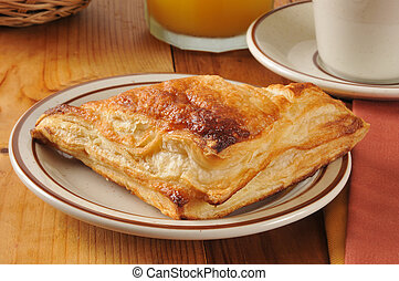Apple turnover - golden flaky apple turnover with orange...