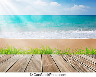 Wood terrace on the beach with green grass and sun light