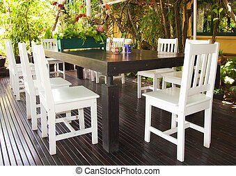 Wooden dining table set at restaurant