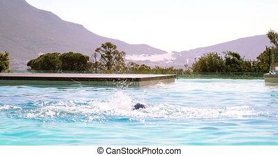 Fit swimmer doing butterfly stroke