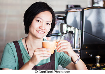 Asian barista enjoy her coffee, stock photo