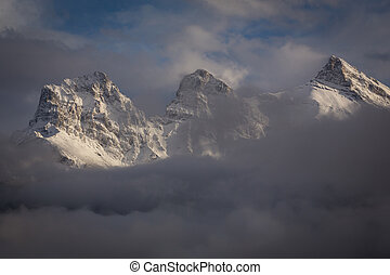 Snowy Mountain Range 1 - Clouds breaking to reveal fresh...