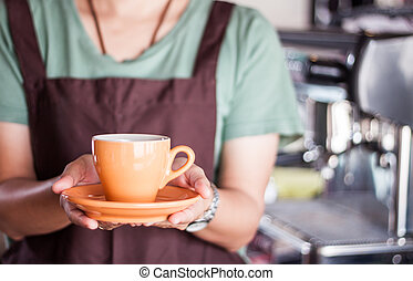 Barista presents freshly brewed coffee, stock photo