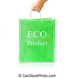 Hand hold green paper shopping bag on reflect white floor....
