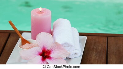 Towels candles and pink flower by t