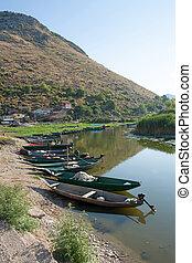 Skadar lake, Montenegro - Some boats in the Skadar lake,...