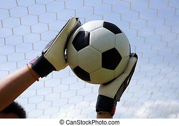 goalkeepers hands reaching foot ball - goalkeepers hands...