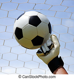 goalkeepers hands hitting foot ball - goalkeepers hands...