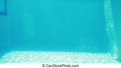 Man diving into blue swimming pool